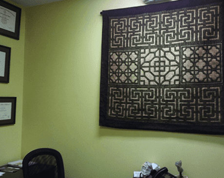 brown and beige decorative wall-hanging.