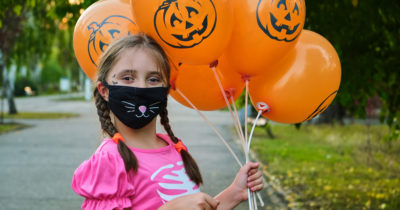 girl in mask enjoying halloween