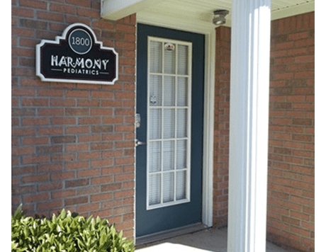A photograph of the front door of Harmony Pediatrics.
