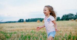 girl running through field