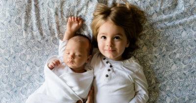 Kid siblings in bed